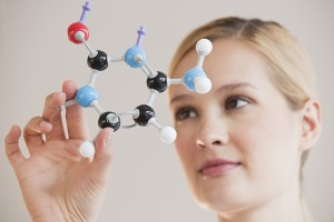 Female Chemist with molecules